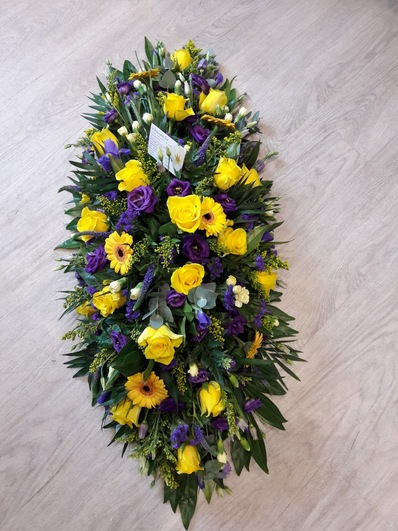 casket spray yellow and purple